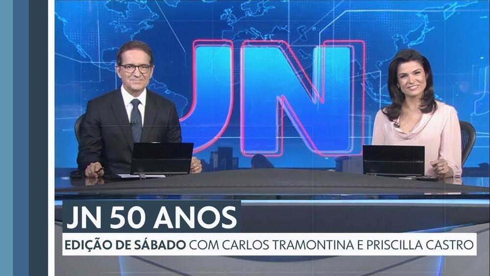 Priscilla Castro e Carlos Tramontina durante apresentação da edição comemorativa do Jornal Nacional — Foto: Globo